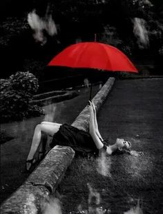 A splash of red in an umbrella of black and white photography! I love colors! They enrich us, but black and white photography strips all to the infinities of a photo/image!
