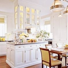 Love this idea: cabinets hanging above an island!