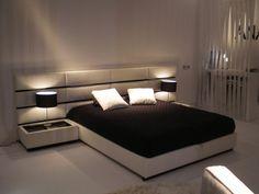 Decoração de quarto em preto e branco com cabeceira estofada