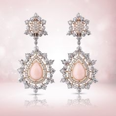 """White gold leaves set with diamonds surround the lovely drop-shaped bezels in pink gold set with a coral contoured by a rivière in pink gold and diamonds. The """"Summer Lady"""" pendant earrings radiate beauty, femininity and allure.   #Buccellati #HighJewelry"""