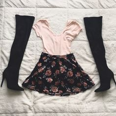 """Forever 21 Velvet Skirt Material: Black background blush roses w/ pale blue leaves - velvet feel - 91% polyester 9% spandex - elastic waistband - full skater shape - not sheer  Measurements: waist 12"""" - waist to hem 14.5"""" - fullness 29"""" - can fit XS to S  Condition: worn once - no rips/stains/fading  Style Tip: wear this Forever 21 skater skirt high or low w/ thigh high boots - Trendy shape and design - perfect for any time of year - pair with a tucked in top Forever 21 Skirts Circle…"""