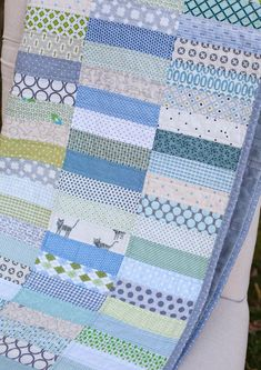 Boys scrappy strip quilt by Stacy Olson