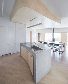 Warm ambient light created by birch plywood complements the kitchen canopy's curvature at a newly completed South Korean residence by BCHO Architects. : Sergio Pirrone. @sandow #architecture #interior #design #interiordesign #kitchen #house #southkorea... - Interior Design Ideas, Interior Decor and Designs, Home Design Inspiration, Room Design Ideas, Interior Decorating, Furniture And Accessories