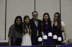The 2013-2014 officers pose with NHS advisor following the induction ceremony.