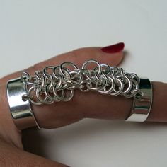 Hey, I found this really awesome Etsy listing at http://www.etsy.com/listing/82272198/silver-chainmaille-ring
