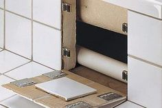 Hidden Compartment in Tile Wall