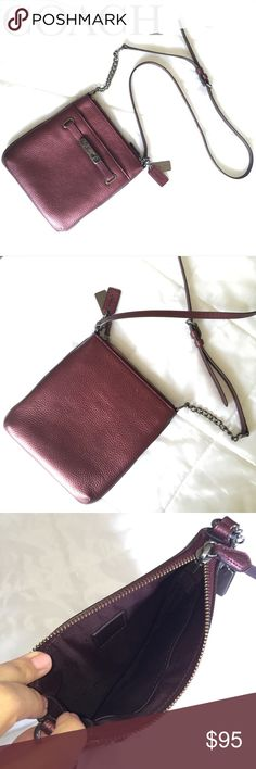Coach Metallic Cherry Small Crossbody Purse ❤️ Stunning Metallic Cherry Colored Small Coach Crossbody! ❤️ Perfect everyday or statement purse! Just the right amount of storage to keep essentials and then some! I hate to see it go, I absolutely LOVE this purse but mom life demanded a larger purse for my stuff plus the little's now.  Only used for about a month, so in excellent loved condition!  Also available in Metallic Blue, see my closet!  Coach Bags Crossbody Bags