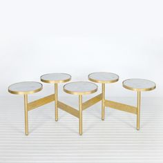 """Hinged gold leaf coffee table with variegated white marble tops. Adjustable 40-70"""" W x 21-27""""D depending on arrangement. Tops are 12"""" diameter."""