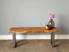 Our reclaimed wood bench with a rare live edge is made from 100+ year old reclaimed elm wood salvaged from a midwestern barn. Years have naturally aged the wood to create a beauty and detail that cannot be replicated! The bench has square steel legs that add a modern, industrial touch.  Wood: Reclaimed Elm Wood Wood Age: 100+ Years Old Wood Thickness: 1.5 - 1.75 Wood Origin: Northern Illinois Height: 18 Width: Varies due to live edge 12.5 - 13 Length: 48 Legs: Hand Welded Steel  Custom sizes…