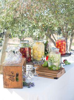 A well stocked beverage bar at Lauren Conrad's wedding via Cassandra Bette Events