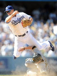 Mark Ellis turns a double play in the Dodgers win over the Pirates 2-1, April 10, 2012.