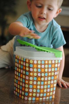Better Homes and Gardens  blogged about using a plastic cereal container and turning it into a trashcan, and I saw the fini...