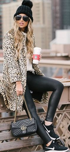 #winter #outfits panther long coat, white shirt, leather leggings, black sneakers,black hat