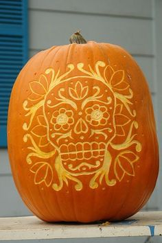 Día de los Muertos Jack-o-lantern!  Would do it on a carve-able pumpkin and cut all the way through.