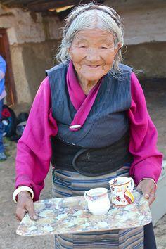 Serving Tibetan butter tea.