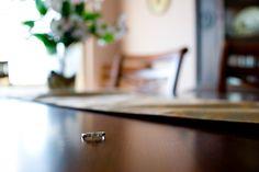 Nathan Desch Photography - wedding ring on table