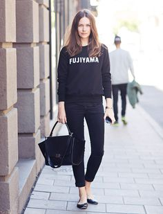 Graphic lightweight sweater with cropped jeans for a comfortable ensemble.