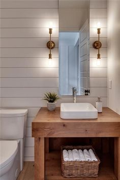 clean wooden vanity, ship lap maybe less blocky sink and water faucet do not like the mirror or lights A view of a dream Modern Farmhouse Kitchen in Trickle Creek Homes' Magnolia Custom Show Home in Calgary, Canada. Modern Farmhouse Powder Room, Rustic Powder Room, Modern Powder Rooms, Modern Farmhouse Kitchens, Modern Room, Kitchen Modern, Kitchen Ideas, Farmhouse Decor, Farmhouse Vanity