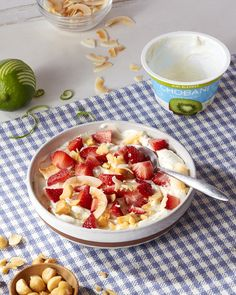 Summer breakfast solved with a Chobani Kiwi Greek Yogurt breakfast bowl.   Ingredients: 1 5.3oz Chobani Kiwi Greek Yogurt ¼ Cup Diced Strawberries 3 Chopped Macadamia Nuts 1 Sprinkle of Toasted Coconut Flakes