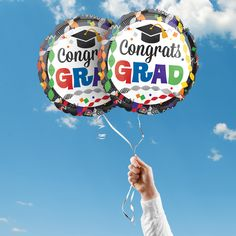 """Includes 2 Congrats Grad 17"""" round graduation foil balloons. """"Congrats Grad"""" is printed on both sides of the balloons. Use balloons for your graduation party centerpieces or balloon bouquets."""