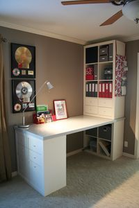 """Love this custom desk space- """"This is my desk project. It was put together with Expedit bookshelves from IKEA, a solid core door (which I painted and polyeurythaned), and storage inserts also from IKEA. I think it turned out rather nicely if I do say so myself!"""""""