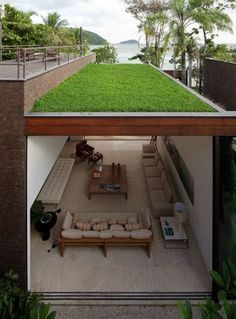 San Sebastian Green Roof House. Low maintenance green roof for porch roof or terrace. Minimalist green roof design.