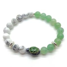 The Sea Turtle bracelet is hand made in England. It features Grade-A Green Aventurine and Howlite gemstone beads, measuring 8mm diameter and threaded on to high-quality stretch cord. The Sea Turtle is Peruvian ceramic and hand painted, measuring approximately 13mm Sea Turtle Bracelet