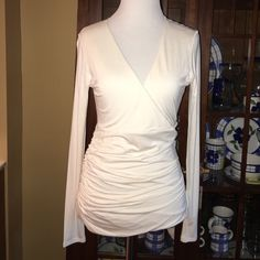 "Boston Proper V-Neck Ruched Long Sleeve Top This is a very pretty cream colored v-neck long sleeve top from Boston Proper in a size small.  It has ruching down the right side and it is made of 95% rayon & 5% spandex so the material gives.  The measurements are as follows: 26"" from top to bottom, 18"" from neckline to bottom & 16"" from armpit to armpit.  Worn only once, this top is in ""like new"" condition. Boston Proper Tops Blouses"