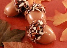 Pretzel Caramel Acorns.  Created with Snyder's of Hanover Pretzel Sticks (could substitute #GF Pretzel Sticks), Caramel squares, and your choice of Peanut butter, or cake frosting, or Nutella.
