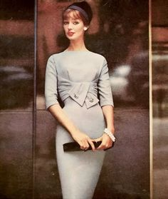 Dolores Hawkins wearing an empire draped wool dress by R & K Originals, hat by John Frederics, 1958