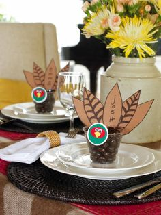 """Easy Thanksgiving place cards/party favors. The cups can be filled with candy corn or chocolates or small baked goodies or any family favorite treats. Or to keep kids entertained (a.k.a. happy) at the table, fill the cups with crayons, provide paper placemats, and ask the kids to help """"decorate"""" the table!"""