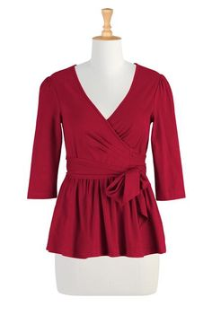 An elastic-waist and sash ties create a flattering silhouette for our soft #knitblouse with a low surplice neckline  #red #redoutfits  http://www.faearch.com/product/eshakti/eshakti-womens-wrap-peplum-knit-blouse,37873188.html