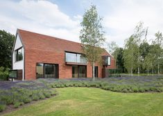 Terracotta tiles cover this house on Belgian farmland, which was designed to match the traditional agricultural architecture of the region Home Building Design, Building A House, House Design, Arch House, House Roof, Contemporary Barn, Contemporary Ceramics, Exterior Tiles, House Cladding