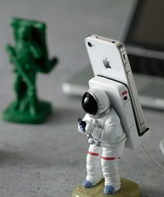 Because astronauts are cool, here's a heavy and sturdy smartphone mount shaped like one that will add a special touch to your workspace.