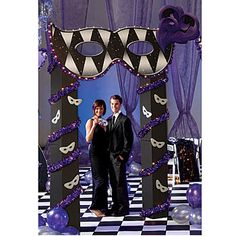 This Lighted Masquerade Arch is decorated with silver masks and purple twistees. Each lighted arch measures 11 ft high x 6 ft wide x 12 inches deep.