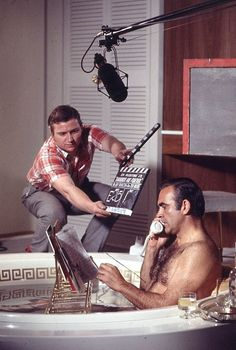 'Damonds are Forever': behind the scenes with Sean Connery reading his newspaper in the bathtub, 1971. This was 7th in the James Bond series to be produced by Eon Productions. It's the sixth and final Eon film to star Connery, who returned to the role as the fictional MI6 agent James Bond, for the first time since You Only Live Twice (1967), having declined to reprise the role in On Her Majesty's Secret Service (1969).