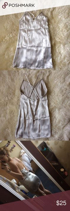 Silver satin slip dress Super silky soft slip dress with adjustable straps. I just got it for Christmas but I have a pretty large chest and kinda fit me awkwardly. My loss your gain!! Never worn, only tried on yet there's a teeny unnoticeable snag on part of the dress (last pic). Bought off the forever 21 site but is by a company called reverse Forever 21 Dresses