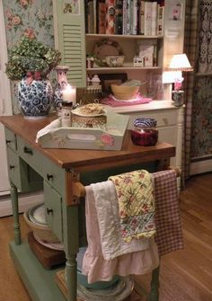 Kitchen island made from an old desk. This setting is so cozy. I want to put Madeleine Peyroux on and bake something or just sip a cup of tea.