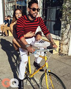 GQ.com: MIGUEL'S OTHER BIKE IS A HARLEYIn blue and white, this sweater would be nautical. But the magic of blood-red-and-black is that it can toughen up anything. (Even a cruiser bike.)Sweater $590 Saint Laurent by Hedi Slimane Jeans $179 Stampd Boots Saint Laurent by Hedi Slimane Bunglasses Salt Optics Her sneakers Topshop for Adidas Originals Bike Tokyobike + Ace Hotel Location Apolis: Common Gallery.