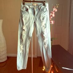 "Straight Leg Jeans Light blue wash, distressed straight leg jeans. Size 9. Stretch. In good condition. Looks cute cuffed with ankle booties and a crop top. 30"" inseam. Jeans Straight Leg"