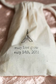 "Looks like hand-stamped favor bags ~ the couple used ""may love grow"" throughout the wedding ~ Photography by charlotteelizabethphoto.com"