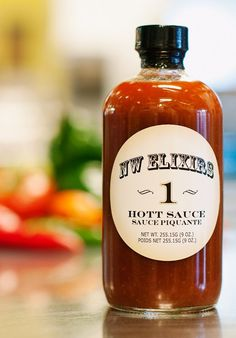 "NW Elixirs Hott Sauce #1 ~ Double ""T"" = double hott! ~ Roasted habenero peppers and dry arbolo chilies combined with just the right amount of Northwest honey and southern spices, create the ideal balance of sweet, smoky and spicy. It's the ideal sauce for absolutely anything."