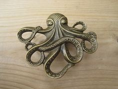 Octopus Drawer knobs in Brass toned Metal MK103 by DaRosa on Etsy, $7.00 - perfect subtle details for the home - the zoologist inside me is geeking out.. cicadas and storks and more!!!