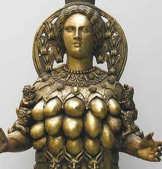 Although the familiar image of Artemis the virginal goddess who rejected men, her temple at Ephesus portrays her as a fertility goddess with many breasts.