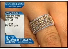 Colored diamonds in a wide band style set in 14k white gold