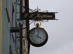 Beautiful artistic shop sign at a clock shop in Teisendorf, Bavaria, Germany.
