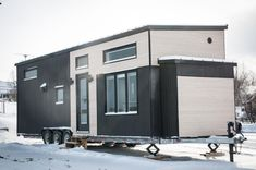 The Ebene is a modern 10' x 34' park model tiny house built by the Minimaliste team in Quebec. The house has a total of 475-square-feet between the main level and two lofts.