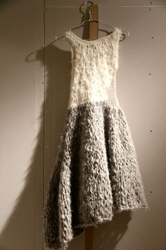 A lovely slub fibre ~ possibly a mix of wool, silk and other? With the weight of the skirt it would become all motion as one moved.