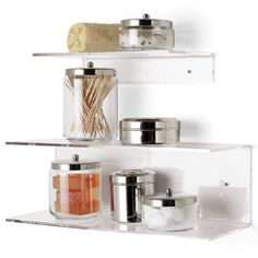 Acrylic shelves from Container Store for under the cabinets for spices, and I can decorate the area flush against the wall, if I want.  I didn't get these, but another set from Amazon, and they are now up with my most frequently used herbs and spices on them.  : D