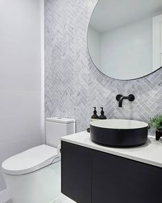 """HERRING TILES The judges loved Kerrie & Spence's Powder Room agreeing that the basin, the mirror and all of the finishes were superb. They said """"yet again beautiful in its simplicity"""" and they were also impressed with the very fancy smart toilet too. Reece Bathroom, Small Bathroom, Master Bathroom, The Block Bathroom, Bathroom With Tile Walls, Bathroom Basin, Family Bathroom, Bathroom Cabinets, Bathroom Fixtures"""